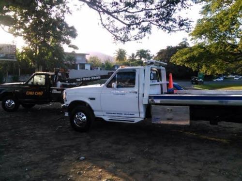 Gruas en Caguas y toda la isla. Taller de mecánica, hojalatería y pintura.  Cambio de gomas, cambio de batería, se abren vehículos cerrados.